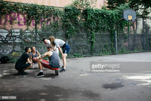 Group Of Urban Basketball Players Huddled Together