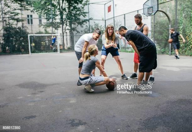 Group Of Urban Basketball Players Making A Game Plan
