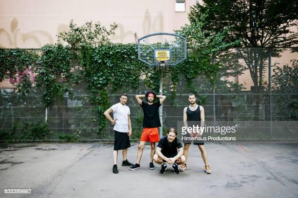 group of urban basketball players posing together - männer über 30 stock-fotos und bilder