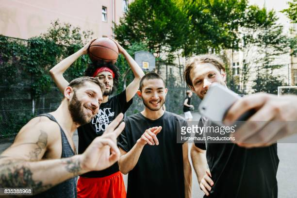 Group Of Urban Basketball Players Taking Selfie Together