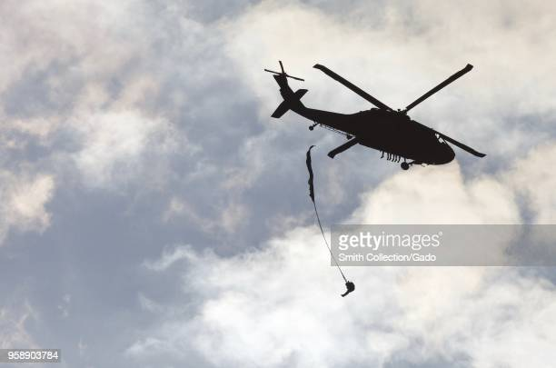 Group of US Army Rangers parachuting from a UH60 Blackhawk Helicopter War Hill Park Dawsonville Georgia May 9 2018 Image courtesy Sgt Austin Berner /...