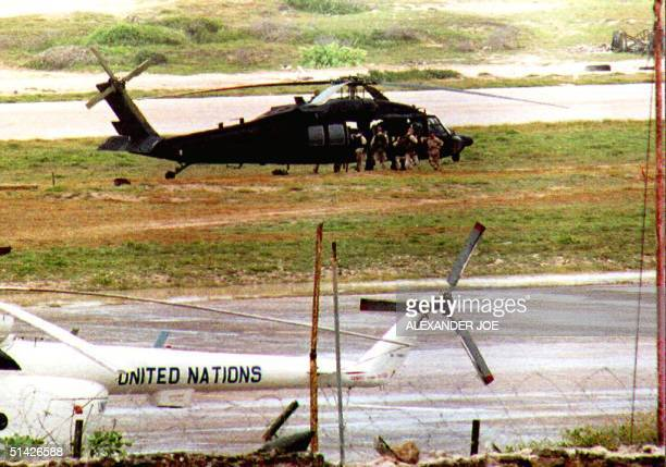 A group of US army Rangers sit in the door of a US Black Hawk helicopter at Mogadishu airport 28 August 1993 A number of US rangers landed here 27...