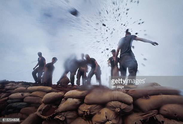 A group of US Marines demolish a bunker during the breakup of the Khe Sanh base Vietnam May 1968