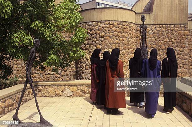Group of veiled women viewing sculptures by Alberto Giacometti in the grounds of Tehran Museum of Contemporary Art, September 1993.