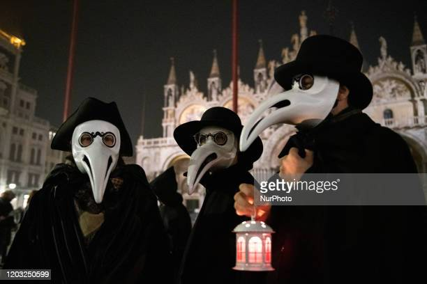 A group of Venetians dressed up like old doctors at the time when in Venice there was the plague celebrate the end of the Venice Carnival despite the...