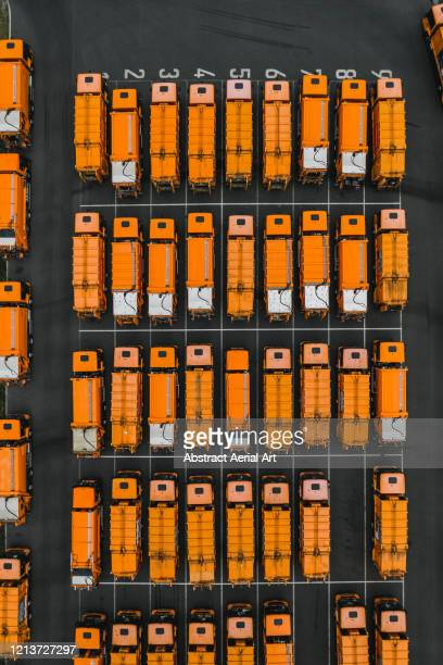 a group of vibrant coloured garbage disposal vehicles as seen from above, berlin, germany - garbage truck stock pictures, royalty-free photos & images