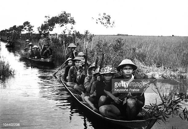 A group of Viet Cong patrolling in a rice paddy The American marines and South Vietnamese units conducted a violent counterattack to Viet Cong...