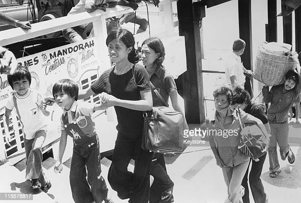 A group of Vietnamese boat people refugees from the freighter 'Song Be 12' arrive in Darwin Australia December 1977