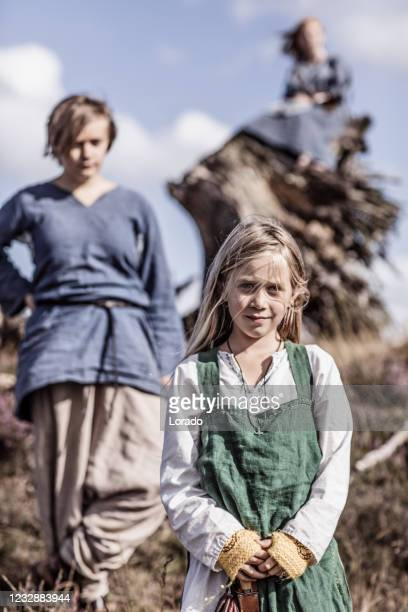 a group of viking children in an outdoor settlement - historical clothing stock pictures, royalty-free photos & images
