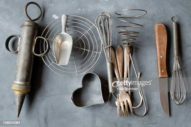 Group of vintage cooking utensils on gray background