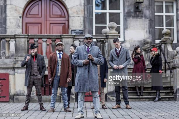 group of vintage gangster men in an old city - gang stock pictures, royalty-free photos & images