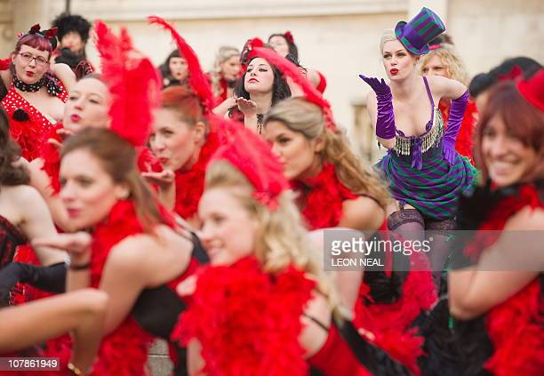 Group of Virgin Holidays staff and burlesque enthusiasts pose in front of the National Gallery in central London during a photocall to launch the...