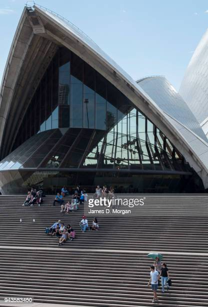 A group of visitors sit in the shade of one of the sails of the Opera House on April 9 2018 in Sydney Australia Sydney has been experiencing...