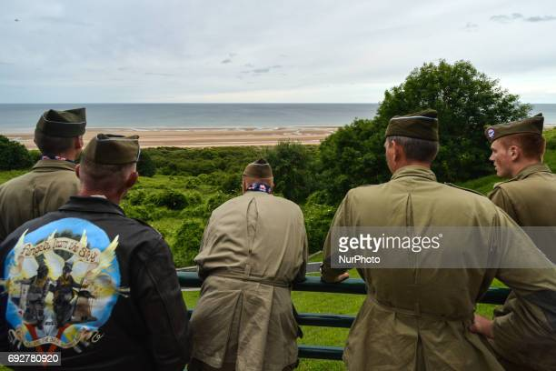 Group of visitors view dressed in 1944 US Army uniforms look at the Omaha Beach from the American Cemetery. Tuesday 6th June is the 73rd anniversary...