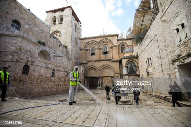 Group of volunteer carry out disinfections works at Church of the Holy Sepulchre as part of precautions of the new type of coronavirus pandemic in...