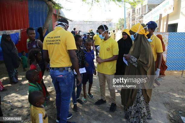 Group of volunteer distribute cleaning supplies to refugees at Barwako refugee camp, expressing things to do to protect against coronavirus , on...