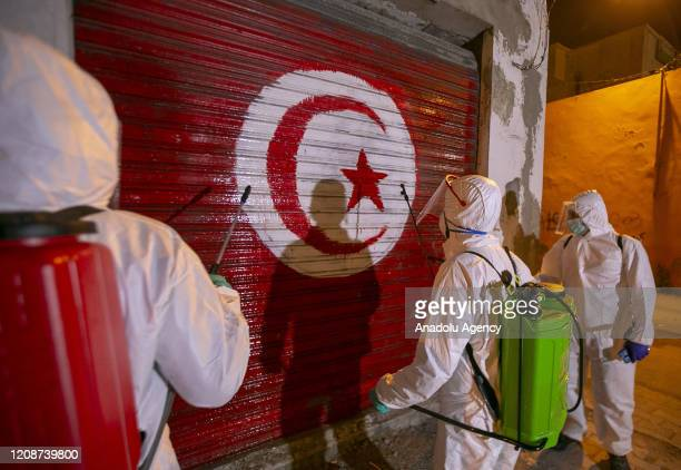 Group of volunteer Tunisian youth carry out disinfection works at streets, workplaces and vehicles as part of measures taken against coronavirus on...