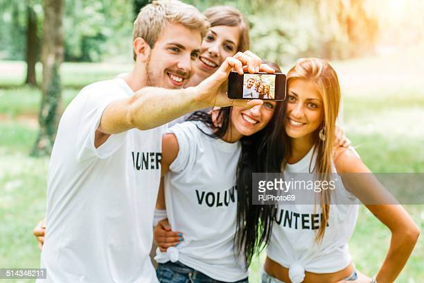 Group of volunteers doing selfie with smart phone