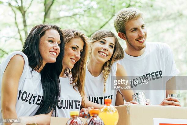 group of volunteers for food donation - pjphoto69 stock pictures, royalty-free photos & images