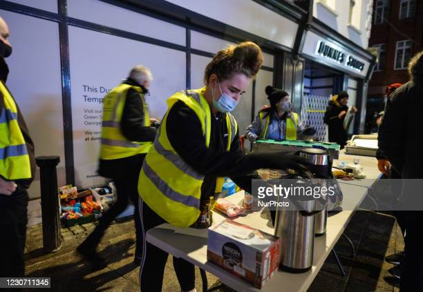 Group of volunteers from the Homeless Mobile Run distributing hot meals, drinks, treats, clothes and toiletries to people in need, outside Dunnes...
