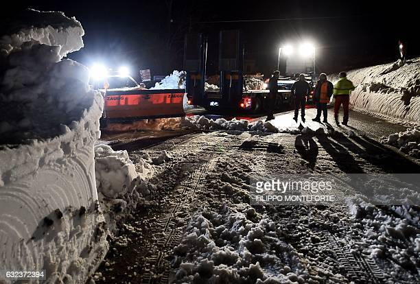 A group of volunteers from Ticino Switzerland prepare to clear a road from snow in the village of Castelli some 15 km from the site where an...