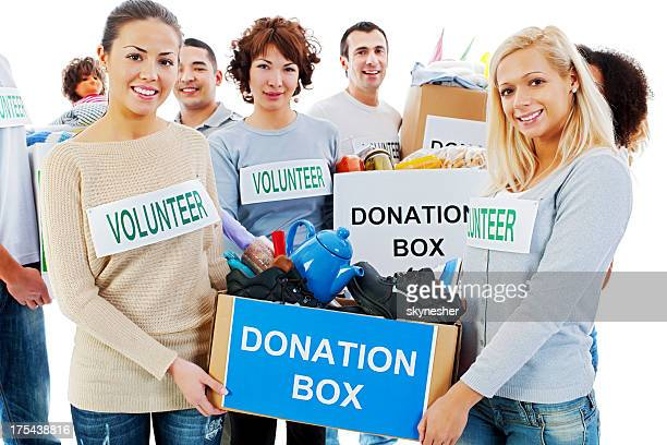 Group of volunteers holding donation boxes.