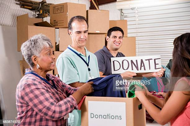 Group of volunteers provide clothing donations to needy families. Charity.