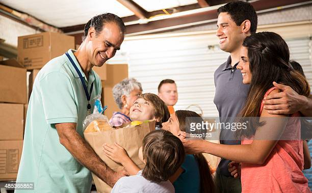 group of volunteers provide groceries donations to needy families. charity. - receiving stock pictures, royalty-free photos & images