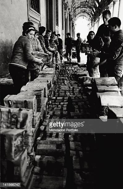 A group of volunteers seeking to salvage a lot of books after the flood Florence November 1966