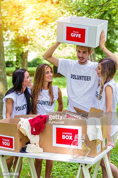 group of volunteers with donation boxes - pjphoto69 stockfoto's en -beelden