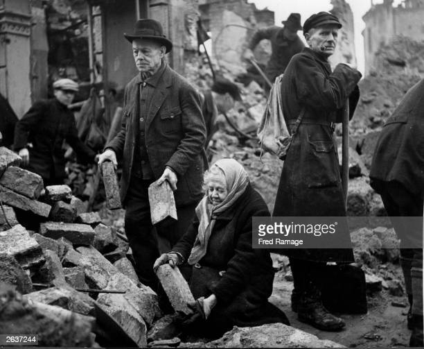 A group of volunteers working to rebuild Dresden Two elderly Germans Gustav and Alma Piltz are assisting in the clearing of rubble