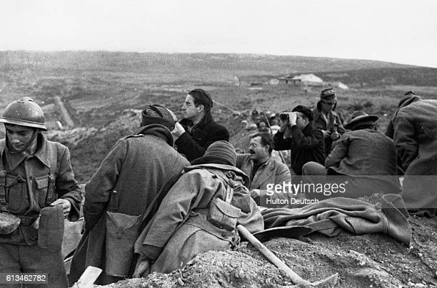 A group of war correspondents gather in a Spanish trench while covering action in the Spanish Civil War American writer and journalist Ernest...