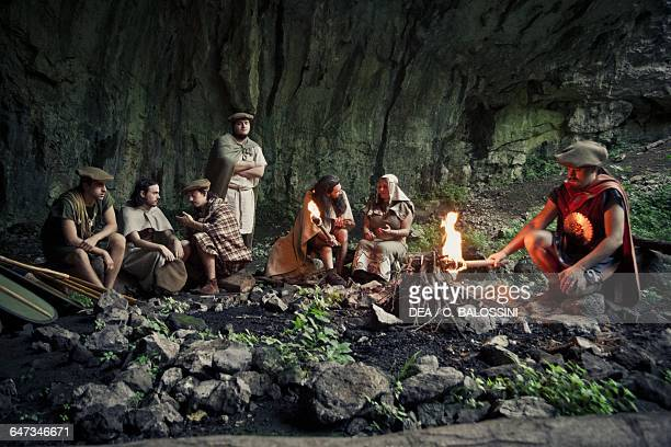 Group of warriors sheltering in a cave at nght and lighting a fire Illyrian civilisation mid3rd century BC Historical reenactment