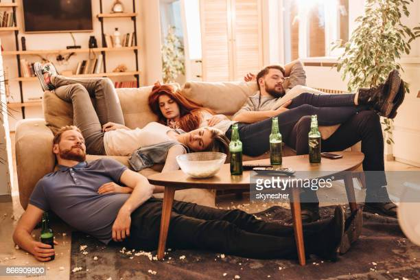 group of wasted friends sleeping after party in the living room. - after party stock pictures, royalty-free photos & images