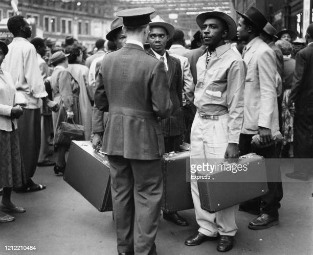 """Group of West Indian immigrants at the port of Southampton, after arriving abroad the Italian steamer """"Venezuela"""" from Jamaica, UK, 25th July 1956."""