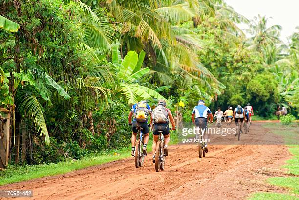 Group of Western Mountain Biker at a dirt road, Cambodia