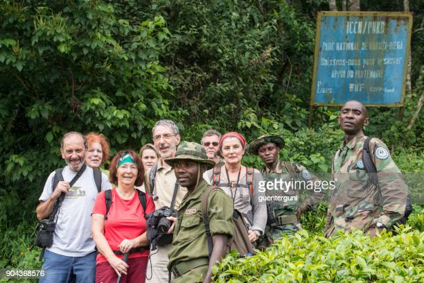 group of western tourists on a gorilla safari, dr congo - virunga national park stock pictures, royalty-free photos & images