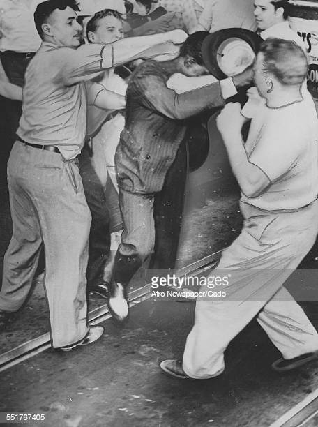 A group of white men punch an unidentified black man during a riot Baltimore Maryland 1943