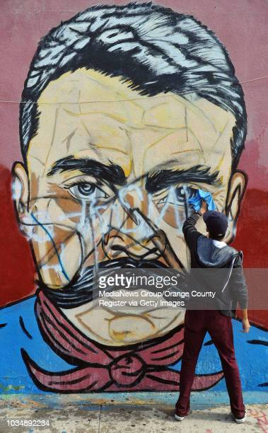 Scott Varley/LANG A group of Wilmington youths will spend the next two weeks restoring a 1979 mural on the walls of the El Mercadito Market at 1210...