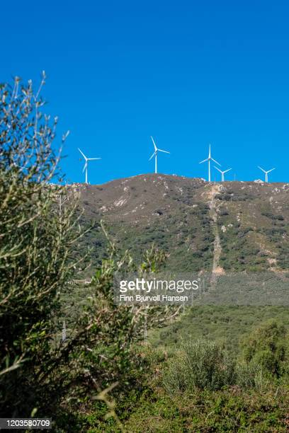 a group of wind turbines against a clear blue sky - finn bjurvoll stock pictures, royalty-free photos & images