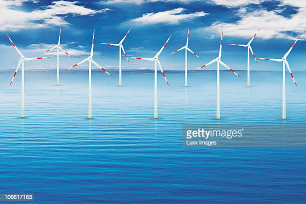 A group of wind turbines in the middle of the sea