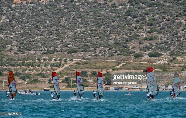 a group of windsurfers at training session at alacati. - emreturanphoto stock pictures, royalty-free photos & images
