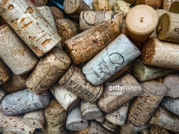 group of wine corks - bottle stopper stock photos and pictures