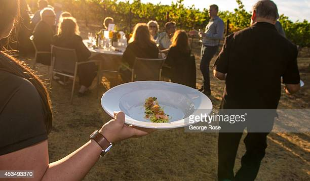 A group of wine lovers take advantage of the warm weather to enjoy a fourcourse dinner catered in a vineyard on July 19 in Healdsburg California...