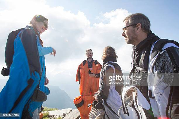 Group of wingsuit jumpersget ready to launch