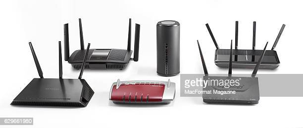 Group of wireless AC routers, including Linksys AC2600, D-Link AC1900, TP-Link AC2600, Synology RT1900ac, FritzBox 7490 and a Netgear Nighthawk,...