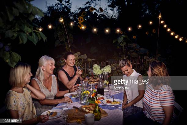 Group of woman at dinner party in garden