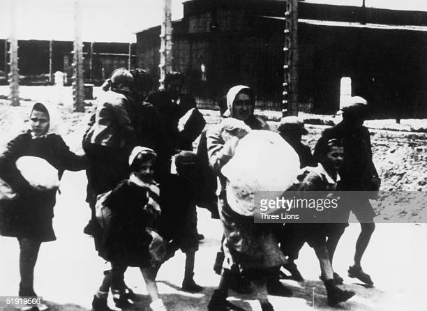A group of women and children arriving at the Nazi concentration camp at Auschwitz Poland circa 1943