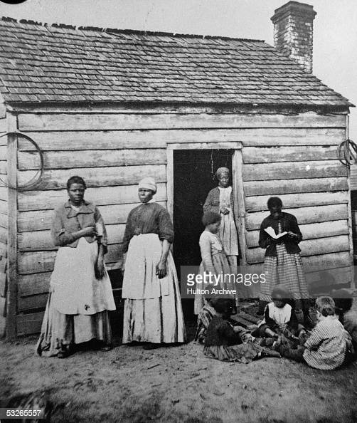 A Group Of Women And Children, Presumably Slaves, Sit And -8778