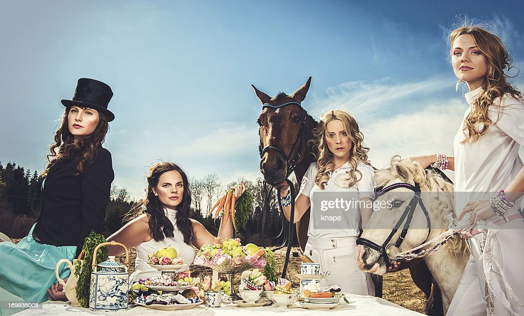 Group of women and horses : Stock Photo